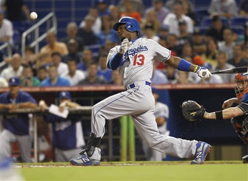 Los Angeles Dodgers' Hanley Ramirez hits his third hit of the night during the seventh inning of a baseball game against the against the Miami Marlins in Miami, Friday, Aug. 10, 2012. (AP Photo/J Pat Carter)