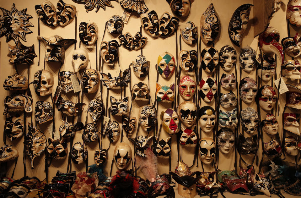 Carnival masks placed on display in a Venetian artisan mask makers shop in Venice, Italy, Saturday, Jan. 30, 2021. Last year, with fear over the new coronavirus mounting, authorities abruptly shut down Venice Carnival on its third day, just before Italy became the first country in the West facing a outbreak. (AP Photo/Antonio Calanni)