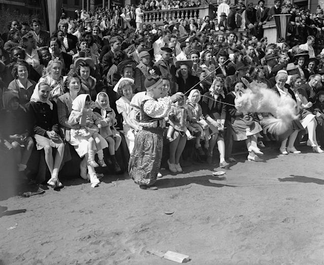 <p>An amused audience watches a clown from the Ringling Brothers Barnum and Bailey Circus put a trained dog through his paces at Bellevue Hospital in New York on April 23, 1942. Occasion was the annual appearance of the circus at the Hospital to do a full show for the benefit of patients, including many children. (AP Photo) </p>