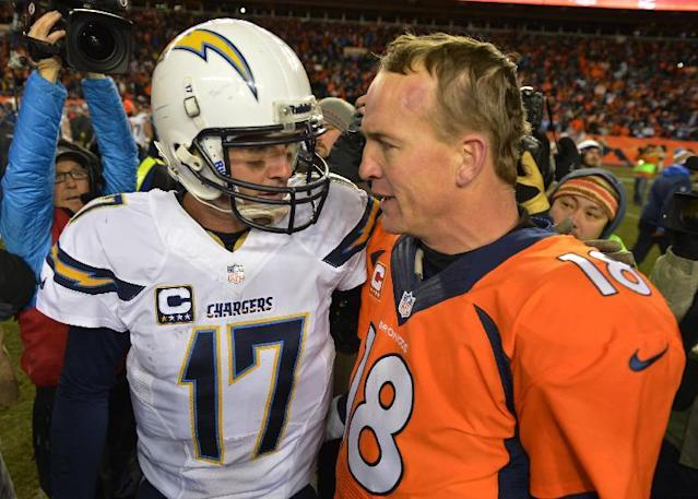San Diego Chargers quarterback Philip Rivers, left, and Denver Broncos quarterback Peyton Manning greet each other at midfield after the Broncos beat the Chargers 24-17 in an NFL AFC division playoff football game, Sunday, Jan. 12, 2014, in Denver. (AP Photo/Jack Dempsey)