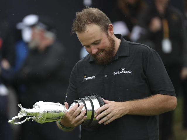 Ireland's Shane Lowry looks down at the Claret Jug trophy on the18th geen after winning the British Open Golf Championships at Royal Portrush in Northern Ireland, Sunday, July 21, 2019.(AP Photo/Peter Morrison)