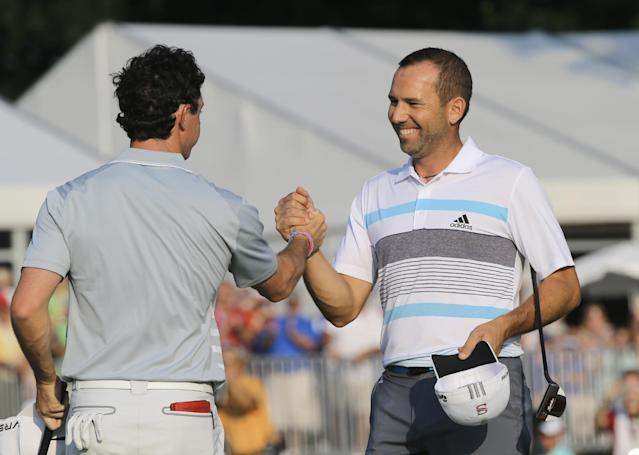 Sergio Garcia, right, congratulates Rory McIlroy after the final round of the Bridgestone Invitational golf tournament Sunday, Aug. 3, 2014, at Firestone Country Club in Akron, Ohio. McIlroy beat Garcia by two shots for the championship. (AP Photo/Mark Duncan)
