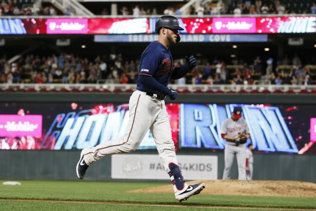 Minnesota Twins' Mitch Garver rounds the bases on a two-run home run off Washington Nationals pitcher Anibal Sanchez, right, in the seventh inning of a baseball game Tuesday, Sept. 10, 2019, in Minneapolis. (AP Photo/Jim Mone)