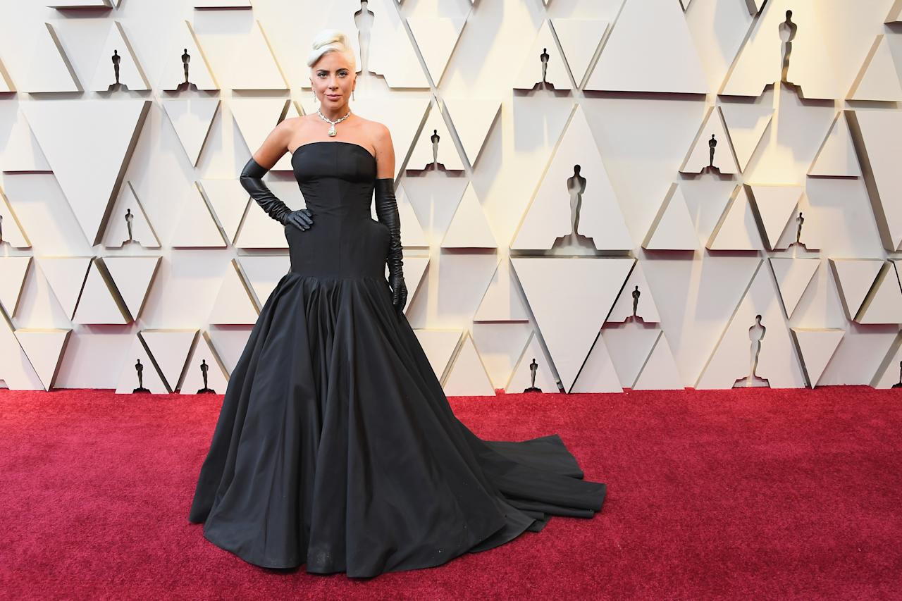 <p>Oozing classic Hollywood glamour, Lady Gaga stunned in a strapless black gown. Source: Getty </p>