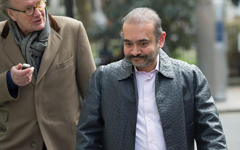 Mr Modi was wearing a £10,000 ostrich hide jacket when confronted in the street by our reporter - © Eddie Mulholland