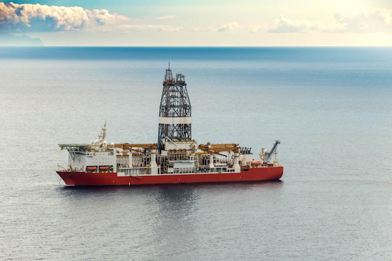 An offshore drillship on the water