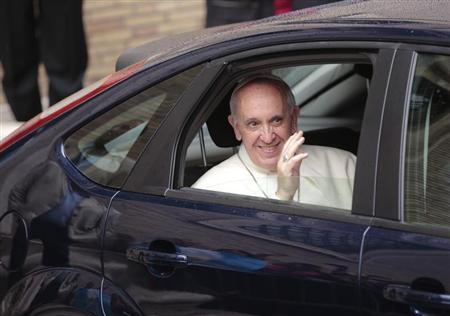 Pope Francis waves as he leaves at the end of a private visit at the Church of the Gesu in Rome