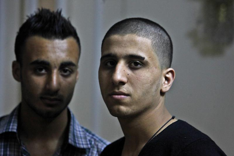 Ayman al-Sayed, 19, right, with his hair cut, and his friend Mohammed Hanouna, 18, left, pose for photo during an interview in Gaza City, Sunday, April 7, 2013. Al-Sayed used to have shoulder-length hair but says he was grabbed by Hamas police in a sweep along with other young men with long or gel-styled spiky hair last week, and that police shaved everyone's head. Hanouna still wears the hair-style that can now get young men in trouble in Gaza, during the Islamic militants latest attempt to impose their hardline version of Islam on Gaza. (AP Photo/Adel Hana)
