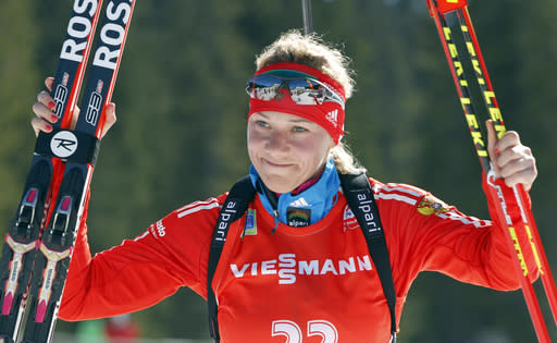 FILE - In this Sunday, March 9, 2014 file photo, Russia's Olga Zaitseva celebrates her third place in the women's 12.5km mass start at the biathlon World Cup competition in Pokljuka, Slovenia. Two-time Olympic biathlon champion Olga Zaitseva lost her appeal Thursday Sept. 24, 2020, against disqualification from the 2014 Sochi Olympics for her part in Russias state-backed doping program. (AP Photo/Darko Bandic, File)