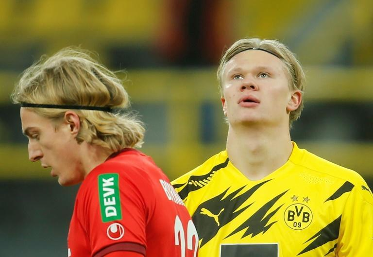 Erling Braut Haaland (R) was not able to rescue Borussia Dortmund against Cologne