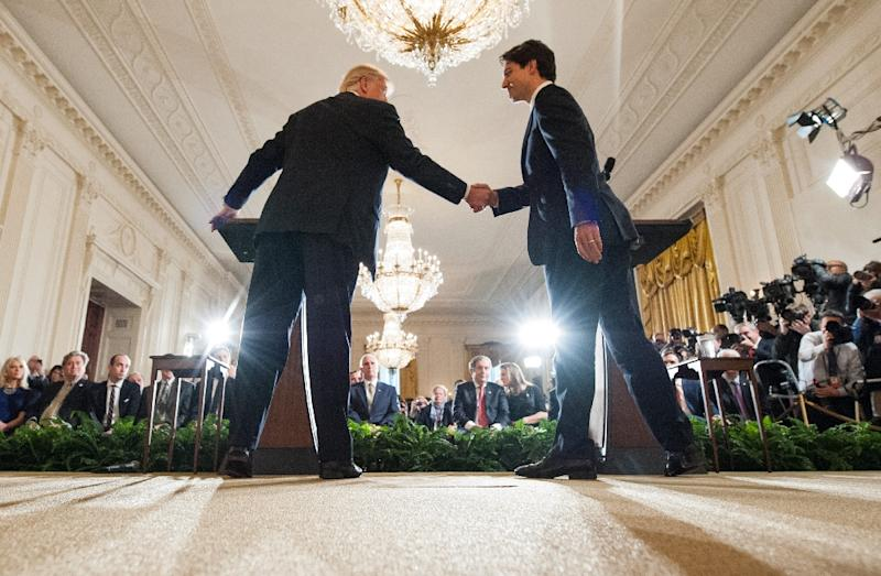 US President Donald Trump and Canada's Prime Minister Justin Trudeau shake hands during a joint press conference in the East Room of the White House on February 13, 2017 (AFP Photo/MANDEL NGAN)