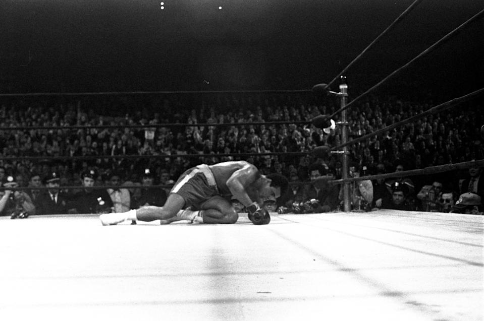 <p>Muhammad Ali is down on the canvas after being floored by Joe Frazier in the 15th round of their heavyweight title fight in New York, March 8, 1971. Frazier won on a decision. (AP Photo)</p>