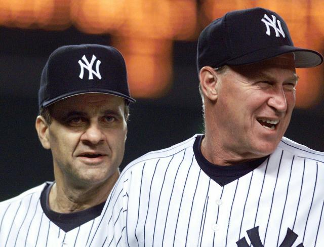 FILE - In this Aug. 27, 1999 file photo, New York Yankees manager Joe Torre, left, and pitching coach Mel Stottlemyre head onto the field to congratulate their players after the Yankees defeated the Seattle Mariners 8-0 in New York. Stottlemyre, the former ace who later won five World Series rings as the longtime pitching coach for both the New York Yankees and Mets, has died. He was 77. The Yankees said Stottlemyre died Sunday, Jan. 13, 2019. He had been living in the Seattle area and had multiple myeloma for nearly 20 years. (AP Photo/Mark Lennihan, File)