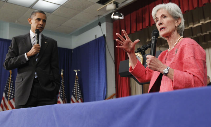 """FILE - In this June 8, 2010 file photo, President Barack Obama listens as Health and Human Services Secretary Kathleen Sebelius speaks during a town hall meeting on the Affordable Care Act, at the Holiday Park Multipurpose Senior Center in Wheaton, Md. Medicare's prescription coverage gap is getting noticeably smaller and easier to manage this year for millions of older and disabled people with high drug costs. The """"doughnut hole""""will shrink about 40 percent for those unlucky enough to land in it, according to new Medicare figures provided in response to a request from The Associated Press. (AP Photo/Alex Brandon, File)"""
