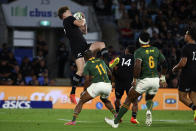 New Zealand's Jordie Barrett, left, aches a high ball during their Rugby Championship test match against South Africa on the Gold Coast, Australia, Saturday, Oct. 2, 2021. (AP Photo/Tertius Pickard)