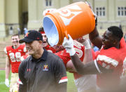 VMI head coach Scott Wachenheim is set to receive a celebratory bath from Marshall Gill (74) and Wesley Cline after they defeated The Citadel in an NCAA college football game, Saturday, April 17, 2021, in Lexington, Va. (David Hungate/Roanoke Times via AP)