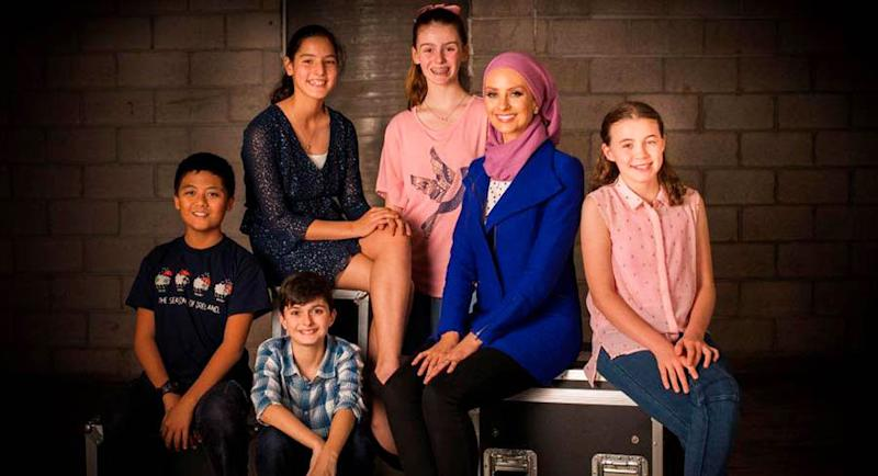 A photo of Dr Susan Carland with season one's Child Genius contestants.