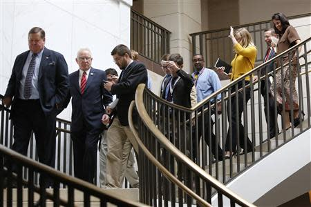 House Armed Services Committee Chairman Buck McKeon (R-CA) (2nd L) is trailed by reporters as he arrives for a closed-door briefing by high-level members of the Obama administration on their proposal to take limited military action in Syria, at the U.S. Capitol in Washington, September 9, 2013. REUTERS/Jonathan Ernst