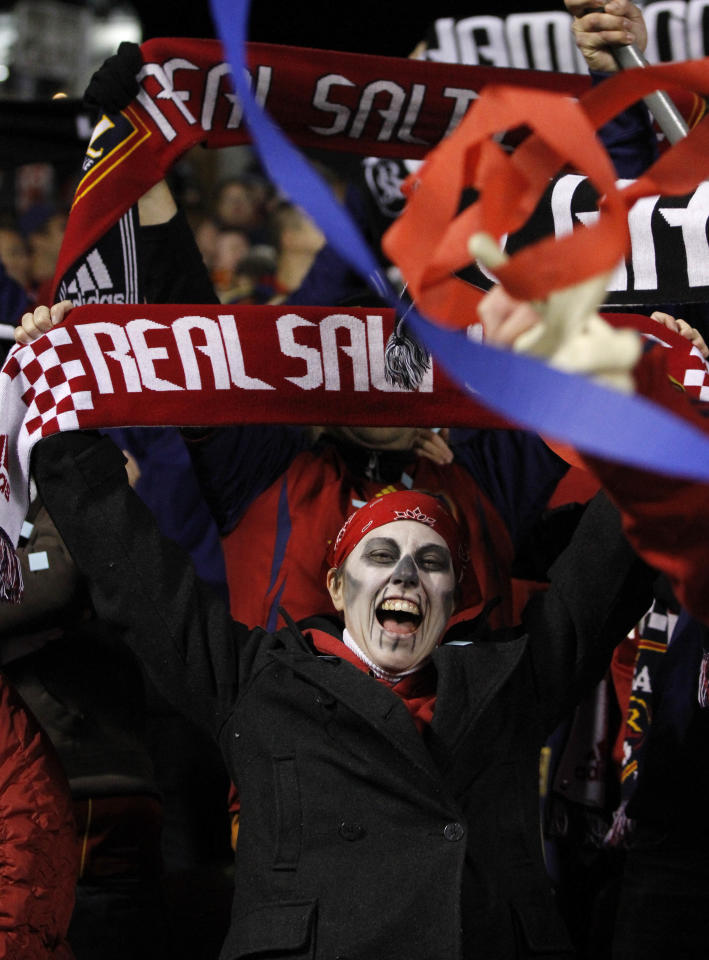 Real Salt Lake fan wearing Halloween make-up Angie Thompson reacts to a goal against the Seattle Sounders during the second half of their MLS playoff soccer match, Saturday, Oct. 29, 2011, in Salt Lake City. Real Salt Lake won 3-0. (AP Photo/Jim Urquhart)