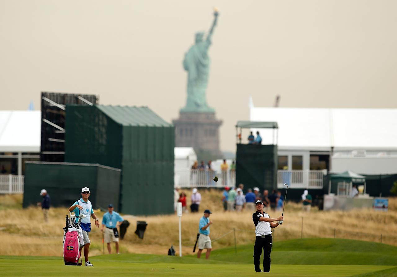 JERSEY CITY, NJ - AUGUST 22: Jonas Blixt of Sweden watches his second shot from the third fairway during the first round of The Barclays at Liberty National Golf Club on August 22, 2013 in Jersey City, New Jersey. (Photo by Darren Carroll/Getty Images)