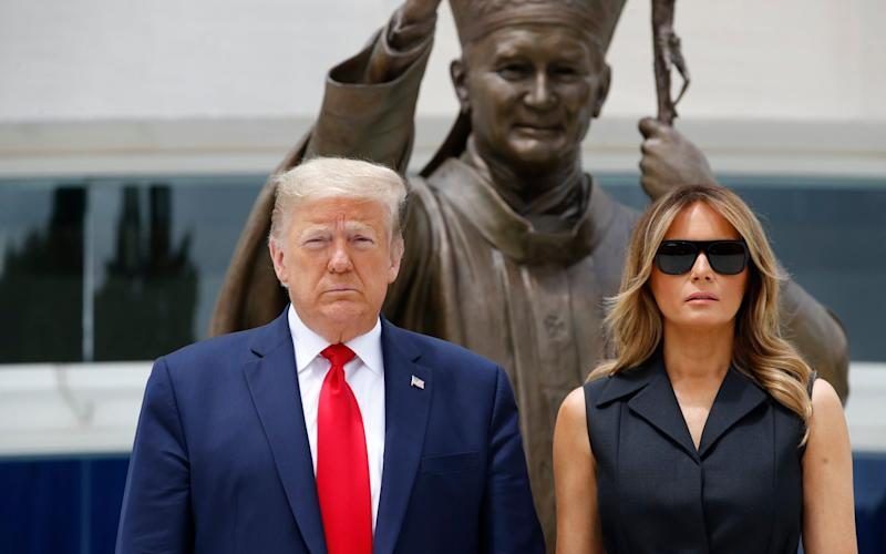 Donald Trump and first lady Melania Trump on a visit to a Catholic shrine yesterday
