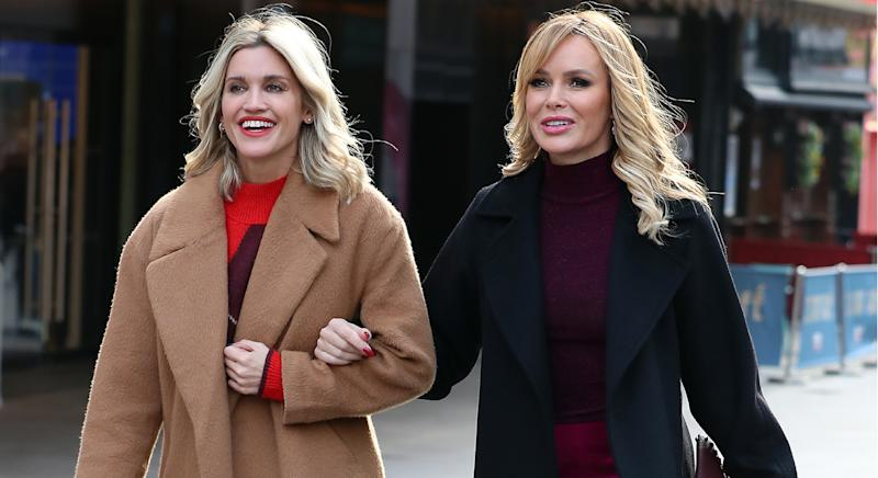 Amanda Holden and Ashley Roberts twin in short suits as they co-host Heart Breakfast Radio show together. (Getty Images)