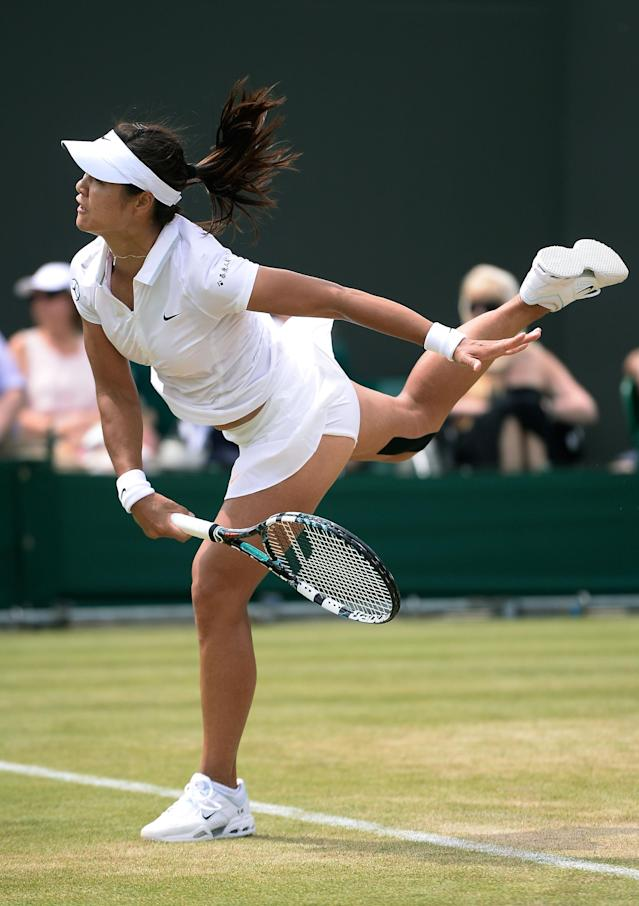 LONDON, ENGLAND - JULY 01: Na Li of China serves during her Ladies' Singles fourth round match against Roberta Vinci of Italy on day seven of the Wimbledon Lawn Tennis Championships at the All England Lawn Tennis and Croquet Club on July 1, 2013 in London, England. (Photo by Dennis Grombkowski/Getty Images)