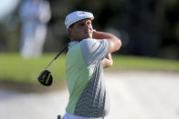 Bryson DeChambeau tees off on the 3rd hole during the second round of the Masters Friday, Nov. 13, 2020, in Augusta, Ga. (Curtis Compton/Atlanta Journal-Constitution via AP)
