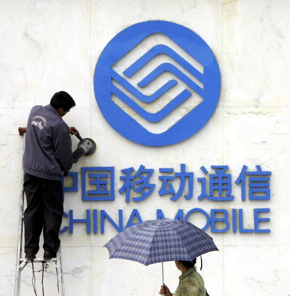 China Mobile is a state-owned telecommunication company that provides multimedia services through its nationwide mobile telecommunications network. The company is the world's largest mobile operator group with <b>683.08 million connections</b> and is listed on both the NYSE and the Hong Kong stock exchange. It generates revenue of $22.05 billion (Photo: Getty Images)