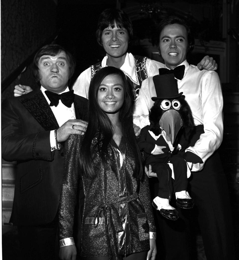 Les Dawson (left) Cliff Richard (Centre back) Wei Wei Wong (centre front) Jose Luis Moreno (right) in November 1973.;  (Photo by Monitor Picture Library/Photoshot/Getty Images)