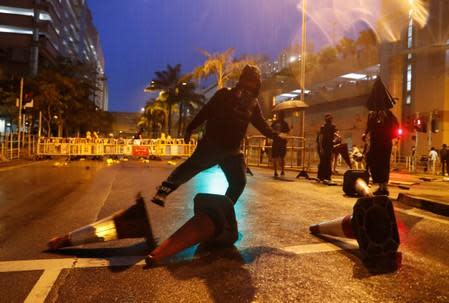 Anti-government protesters set up a roadblock during a demonstration in Tin Shui Wai in Hong Kong