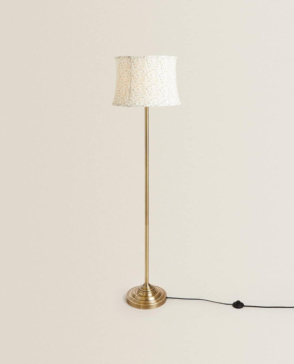 "This lamp is pure cottagecore on top with its delicate floral print, with a suggestion of hardcore in the metal stand.<br><br><strong>Zara Home</strong> Stem Lamp With Printed Shade, $, available at <a href=""https://www.zarahome.com/gb/living-room/lighting/stem-lamp-with-printed-shade-c1020264593p301995338.html?ct=true"" rel=""nofollow noopener"" target=""_blank"" data-ylk=""slk:Zara Home"" class=""link rapid-noclick-resp"">Zara Home</a>"