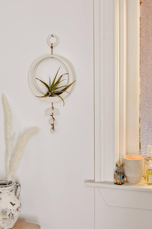 "<p>Spice up their walls with the geometric <a href=""https://www.popsugar.com/buy/Pamina-Air-Plant-Holder-529096?p_name=Pamina%20Air%20Plant%20Holder&retailer=urbanoutfitters.com&pid=529096&price=39&evar1=casa%3Auk&evar9=45914034&evar98=https%3A%2F%2Fwww.popsugar.com%2Fhome%2Fphoto-gallery%2F45914034%2Fimage%2F46995363%2FPamina-Air-Plant-Holder&list1=shopping%2Cgifts%2Cgift%20guide%2Chouse%20plants%2Cplants%2Chome%20shopping&prop13=api&pdata=1"" rel=""nofollow"" data-shoppable-link=""1"" target=""_blank"" class=""ga-track"" data-ga-category=""Related"" data-ga-label=""https://www.urbanoutfitters.com/shop/pamina-air-plant-holder?category=SEARCHRESULTS&amp;color=011"" data-ga-action=""In-Line Links"">Pamina Air Plant Holder</a> ($39).</p>"