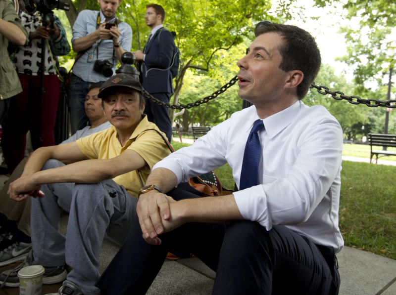 Democratic presidential candidate Mayor Pete Buttigieg, right, attends a rally protesting against President Donald Trump policies outside of the White House in Washington, Wednesday, June 12, 2019. (AP Photo/Jose Luis Magana)