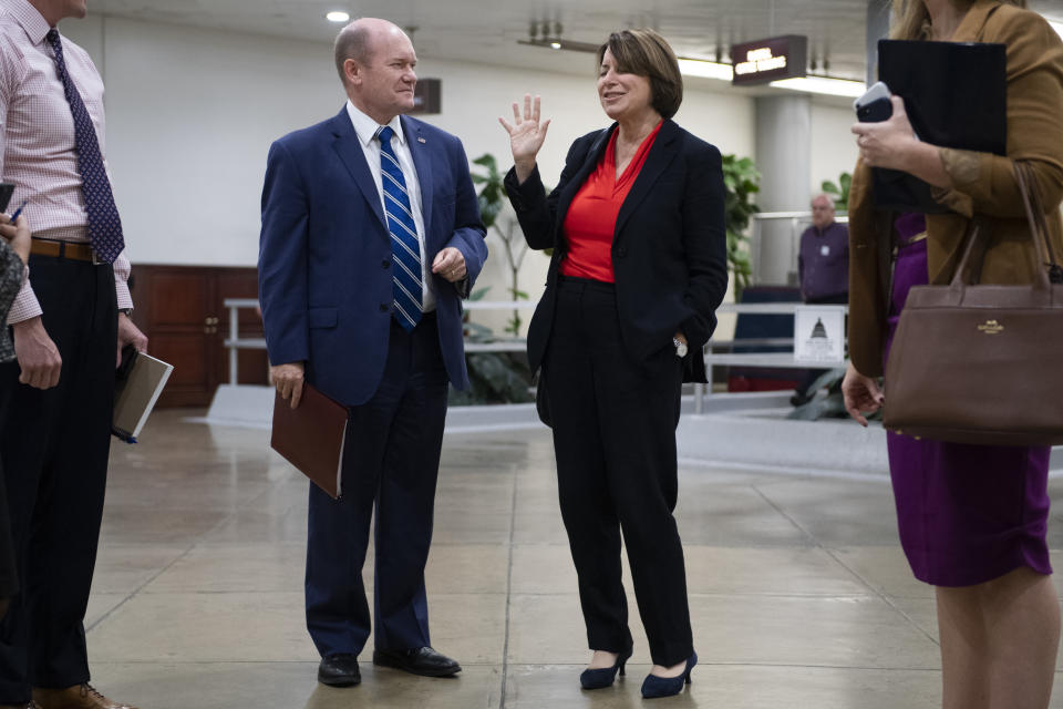 UNITED STATES - OCTOBER 22: Sen. Amy Klobuchar, D-Minn., and Sen. Chris Coons, D-Del., are seen in the Capitols Senate subway on Tuesday, October 22, 2019. (Photo By Tom Williams/CQ-Roll Call, Inc via Getty Images),