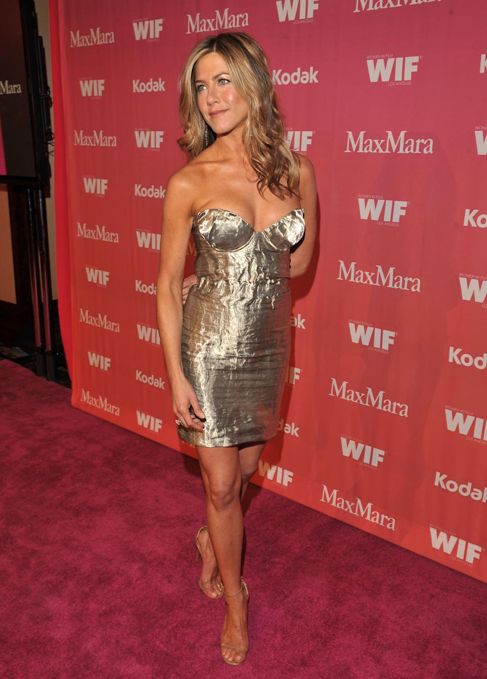 Aniston opted for a silver Prada mini-dress for the 2009 Women In Film Awards. (Photo by Lester Cohen/WireImage)