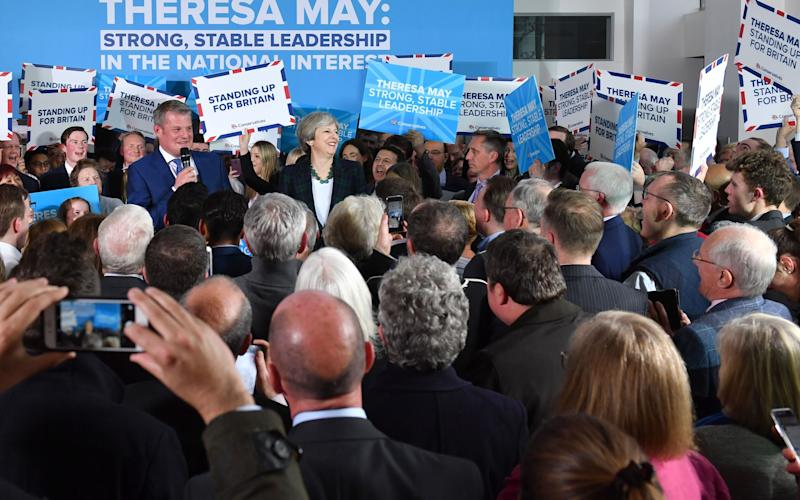 In Leeds on April 27 Conservative signs promote the values of Theresa May... - AFP and licensors