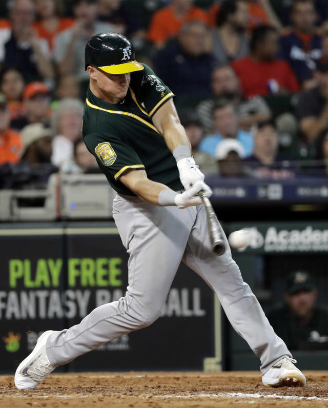 Oakland Athletics' Matt Chapman hits a RBI double during the eighth inning of a baseball game against the Houston Astros Thursday, July 12, 2018, in Houston. (AP Photo/David J. Phillip)