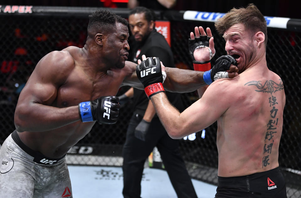 LAS VEGAS, NEVADA - MARCH 27: (L-R) Francis Ngannou of Cameroon punches Stipe Miocic in their UFC heavyweight championship fight during the UFC 260 event at UFC APEX on March 27, 2021 in Las Vegas, Nevada. (Photo by Jeff Bottari/Zuffa LLC)