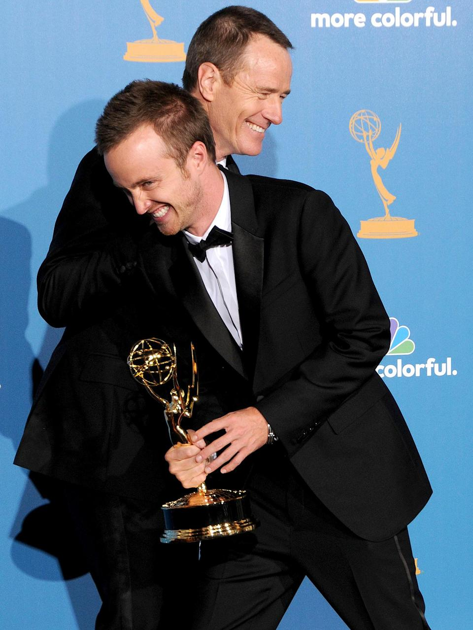 <p><em>Breaking Bad</em> and breaking hearts! Costars Bryan Cranston and Aaron Paul goofed off with their Emmy statuettes. </p>