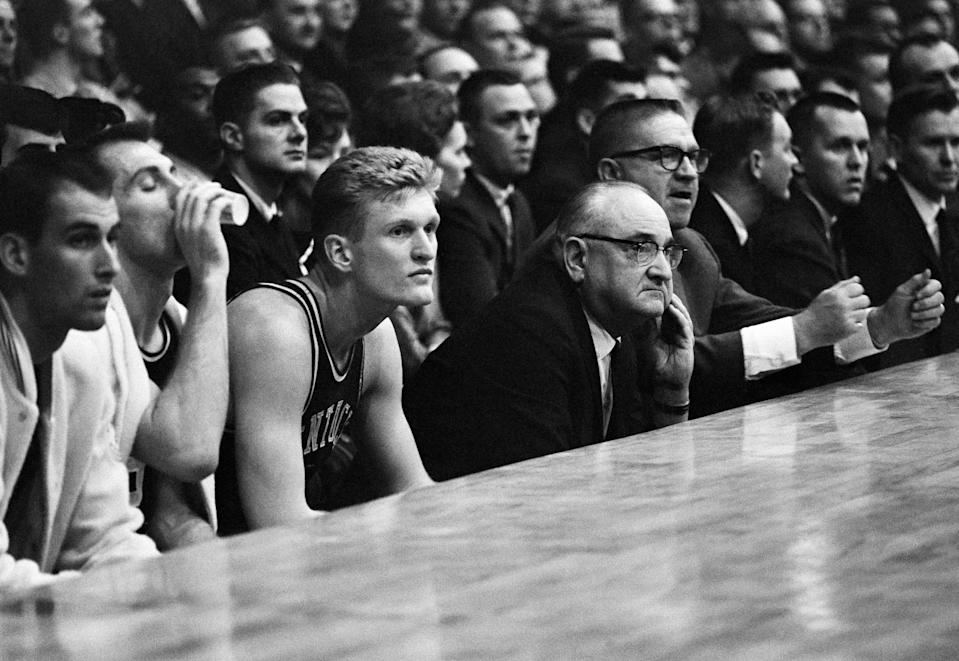 Adolph Rupp, middle, turned Kentucky basketball into a national power, winning four national championships. (AP)