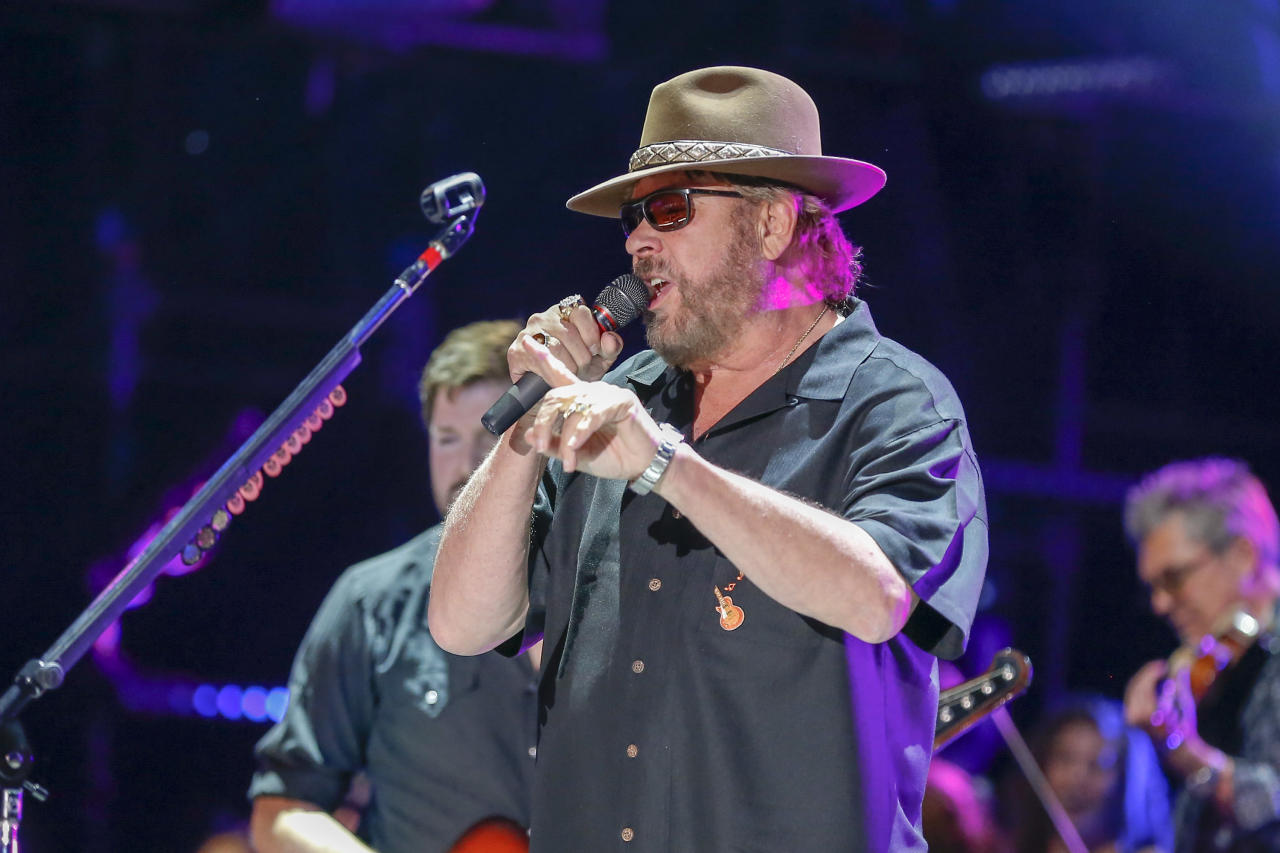 """FILE - In this June 10, 2016 file photo, Hank Williams Jr. performs at the CMA Music Festival at Nissan Stadium in Nashville, Tenn. Williams Jr. is offering a $6,000 reward for his grandfather's missing shotgun. The singer known for hits including """"Family Tradition"""" has posted a letter online saying he spent time growing up in south Alabama with his grandfather. (Photo by Al Wagner/Invision/AP)"""