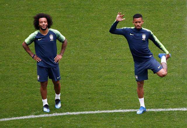 Soccer Football - World Cup - Brazil Training - Saint Petersburg Stadium, Saint Petersburg, Russia - June 21, 2018 Brazil's Marcelo and Gabriel Jesus during training REUTERS/Anton Vaganov