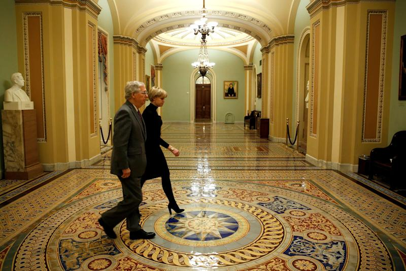 Senate Majority Leader Mitch McConnell (R-Ky.) walks to the Senate floor before a vote to end a government shutdown early Friday.