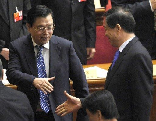 "The public demise of Bo Xilai (R) had brought ""great damage"" to the country, his replacement said on Monday"