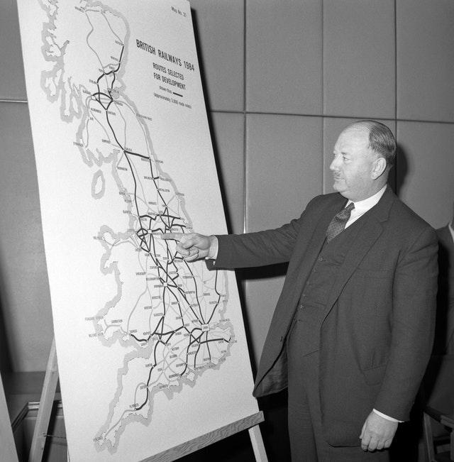 Dr Richard Beeching in 1965 looking at a large map showing how British Rail trunk routes might look in 1984