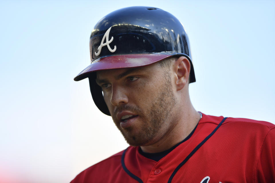 Atlanta Braves Freddie Freeman (5) stands on first base in first in the first inning during Game 2 of a best-of-five National League Division Series against the St. Louis Cardinals, Friday, Oct. 4, 2019, in Atlanta. (AP Photo/John Amis)