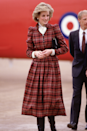 <p>Of course Diana pulls of head-to-toe tartan in this elegant look, worn for a trip to Swindon in Februrary 1985.</p>