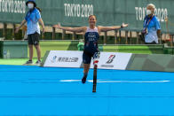 Melissa Stockwell reacts arriving at the finish line in the Women's Triathlon PTS2 at Odaiba Marine Park in the 2020 Paralympics in Tokyo, Saturday, Aug. 28, 2021. (AP Photo/Emilio Morenatti)