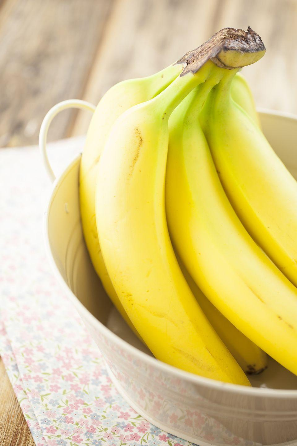 "<p>Bananas lower cholesterol by <a href=""https://www.goodhousekeeping.com/health/diet-nutrition/a47807/banana-nutrition/"" rel=""nofollow noopener"" target=""_blank"" data-ylk=""slk:removing it from your digestive system"" class=""link rapid-noclick-resp"">removing it from your digestive system</a>, preventing it from moving into your bloodstream and clogging your arteries. For an extra heart-healthy boost, slice bananas on top of morning oats with a tablespoon of chia seeds.</p>"